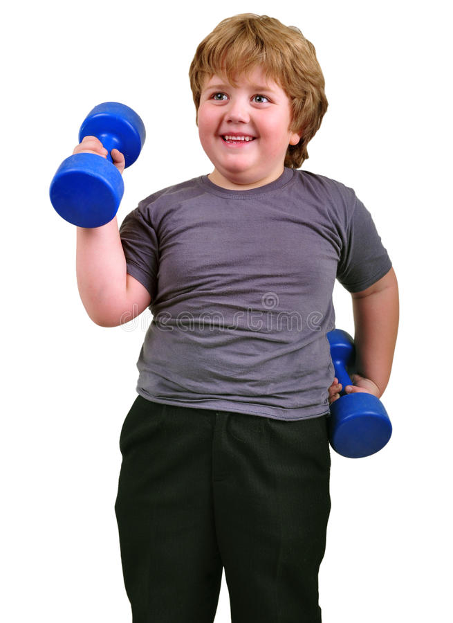Isolated portrait of smiling kid exercising with dumbbells royalty free stock image