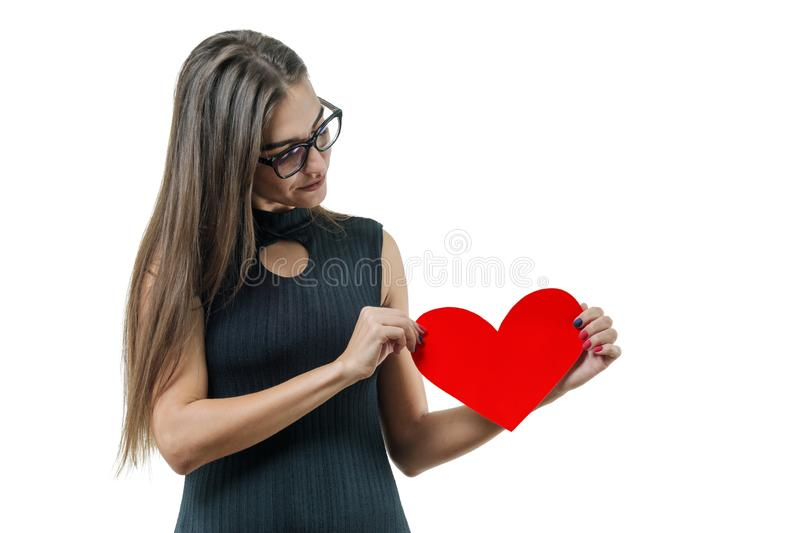 Isolated portrait of young woman with paper red heart stock photo
