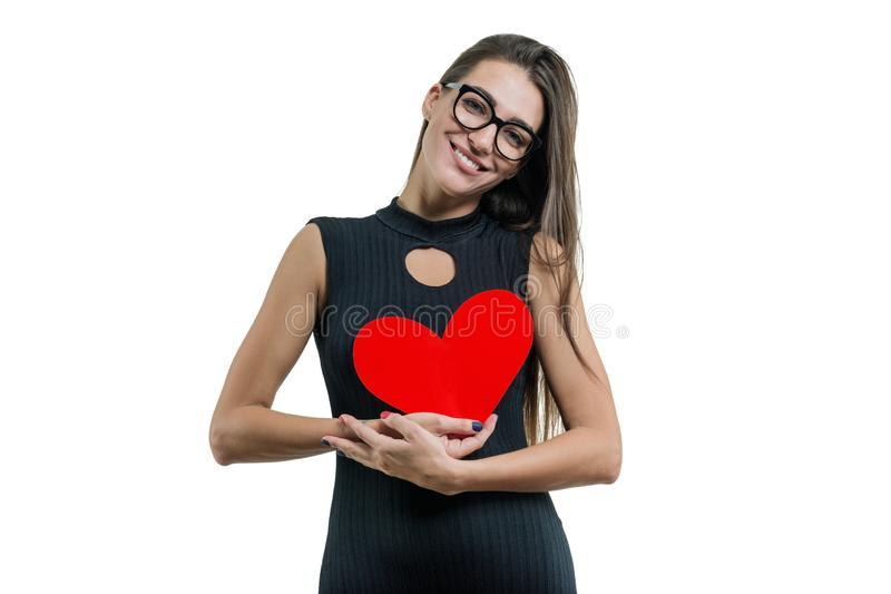 Isolated portrait of young woman with paper red heart royalty free stock photography