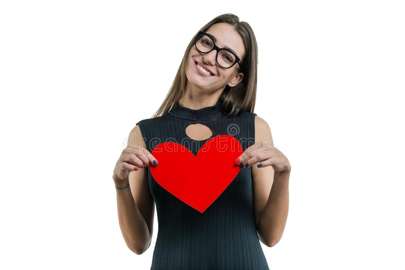 Isolated portrait of young woman with paper red heart stock photos