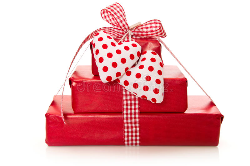Isolated presents wrapped in red paper with hearts royalty free stock photography
