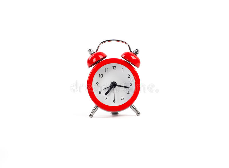 Isolated red alarm clock royalty free stock photography