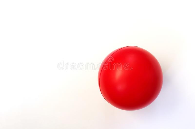 Isolated Red Ball against a White Background. Blank Emoji Ball Plastic | Rubber with Blank Copy Space stock image