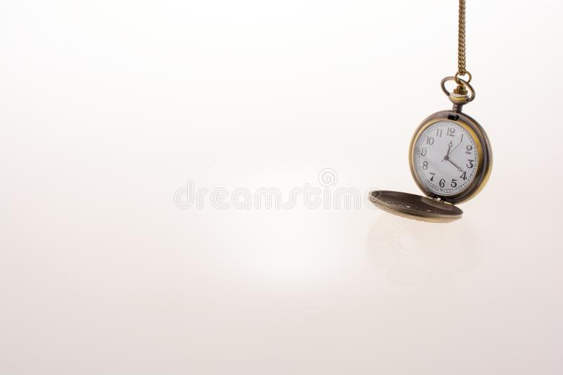 Isolated retro styled pocket watch stock images