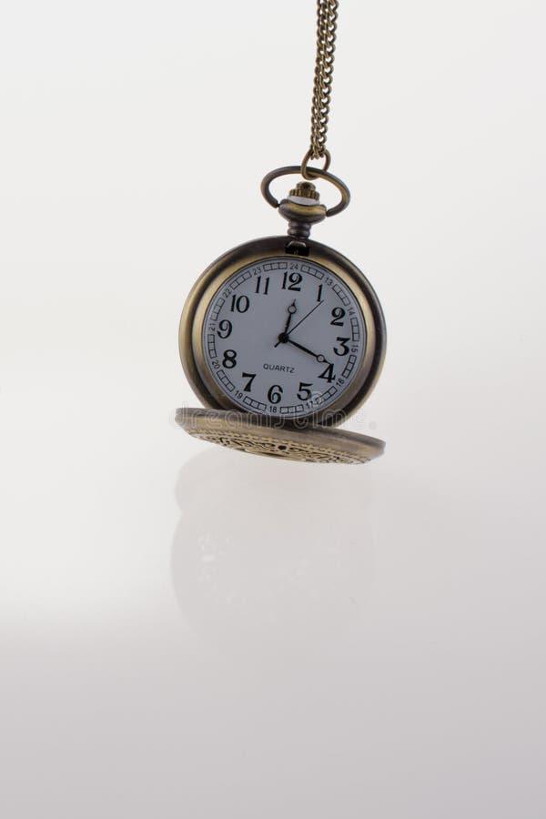 Isolated retro styled pocket watch stock photo