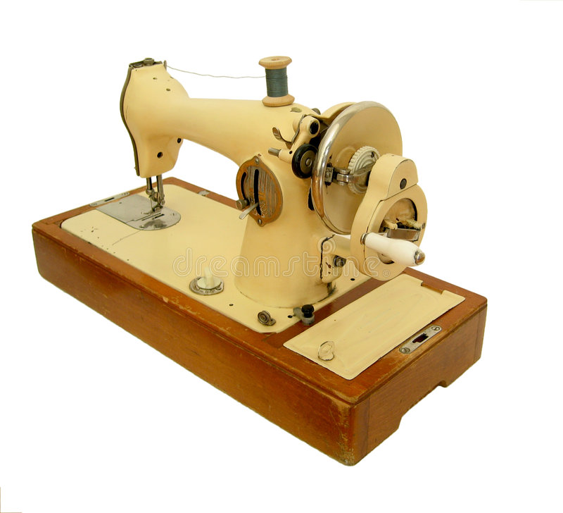 Isolated retro sweing machine. Old metal retro sewing machine with wooden ground royalty free stock image