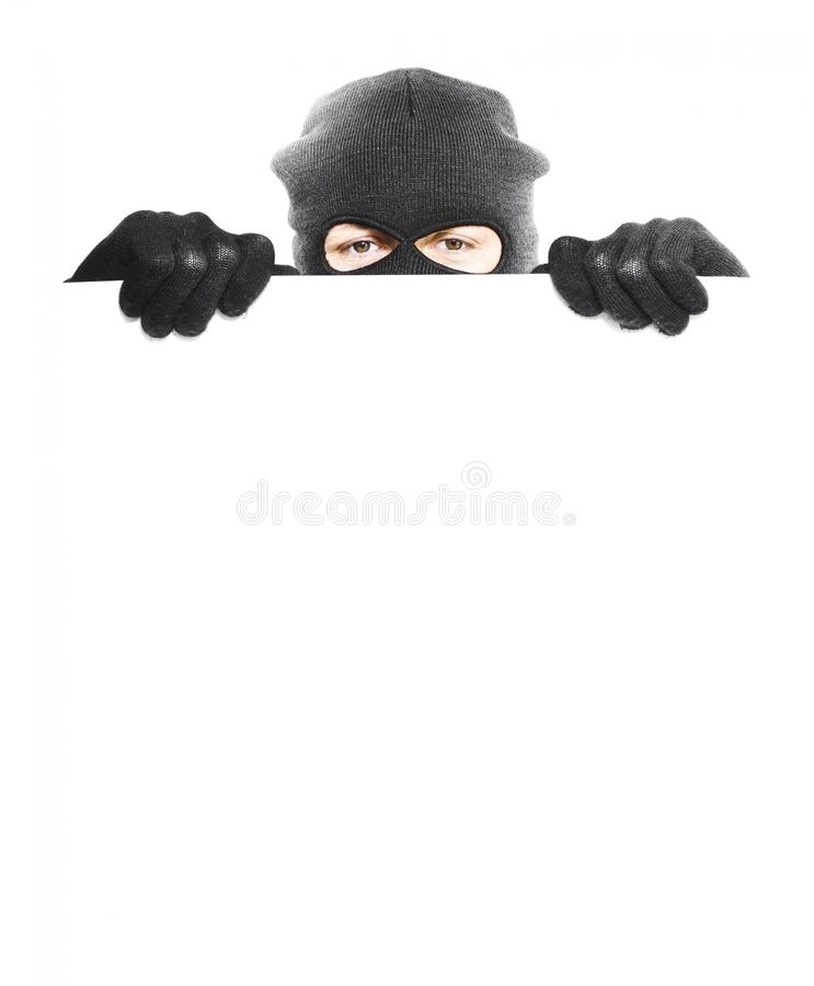 Download Isolated Robber Hiding Behind A Empty White Sign Stock Photo - Image: 25532608