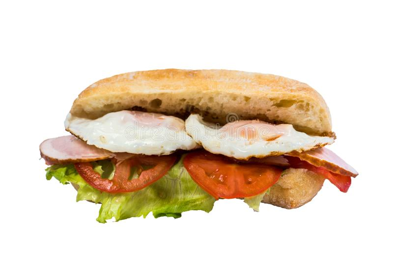 Isolated sandwich fried egg, bacon, fresh vegetables royalty free stock photography