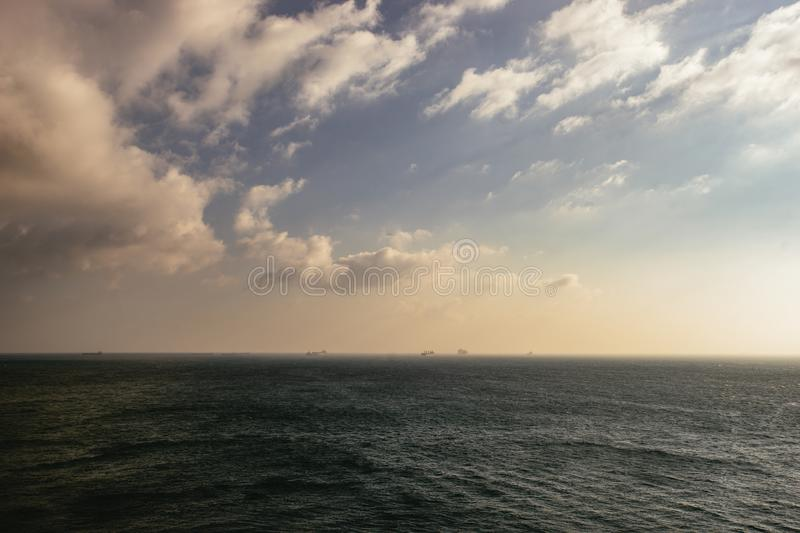 Isolated section of dark ocean water under clouds stock photos