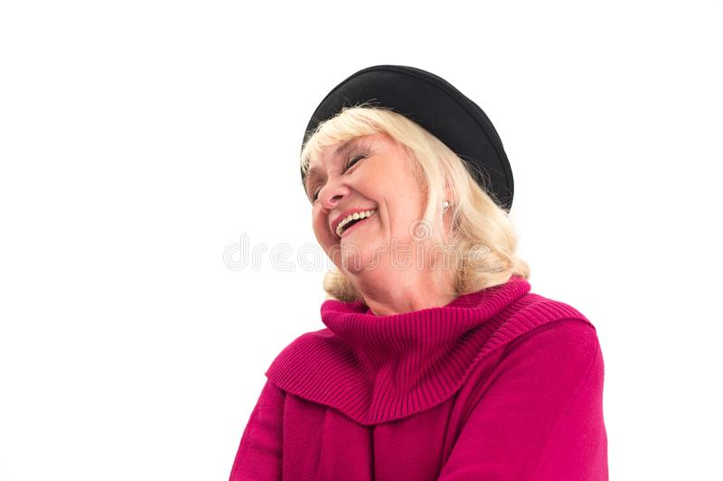 Isolated senior lady laughing. stock images