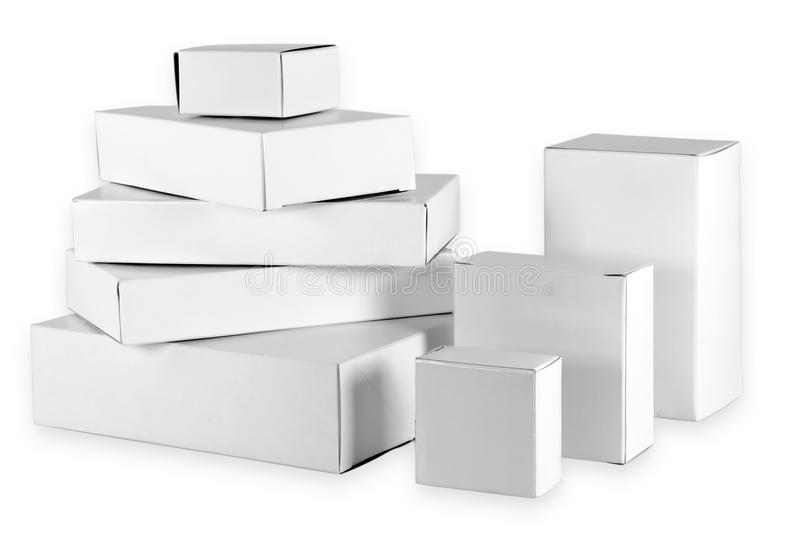 Isolated set of small white cardboard boxes royalty free stock photos