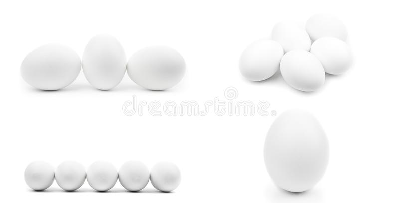 Isolated set of white whole chicken eggs on white background. Realistic natural photography with shadow. Raw chicken eggs close up. Cut off royalty free stock photo