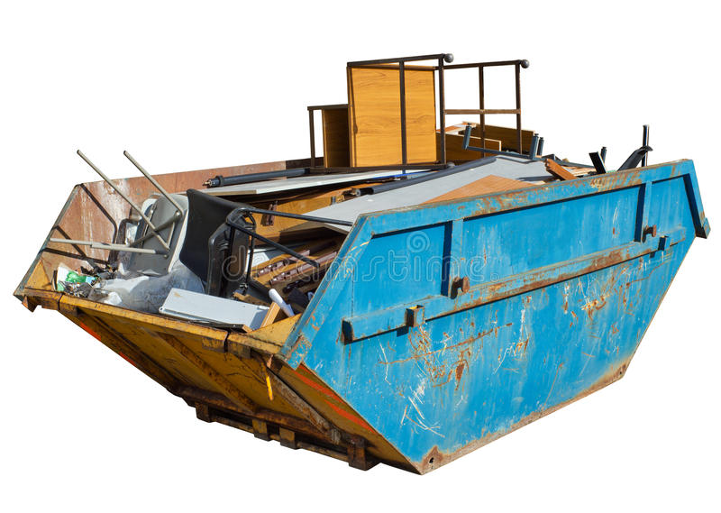 Isolated skip full of old office furniture. royalty free stock photo