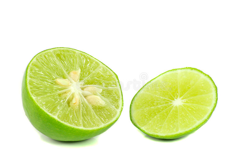 Isolated sliced green lime on a white background stock images