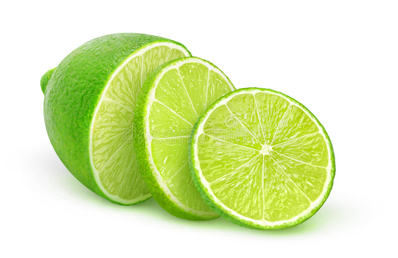 Isolated sliced lime. Isolated lime. Half of lime fruit and two slices isolated on white background with clipping path royalty free stock photography