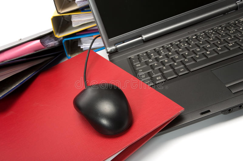 Isolated stack of folders with laptop computer. Shot over white background stock photo