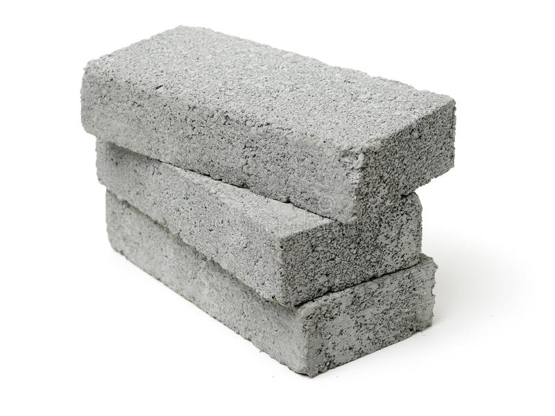 Isolated Stack of gray clay bricks for construction on a white background stock photography