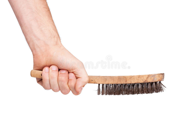 Isolated steel brush in male hand stock photos