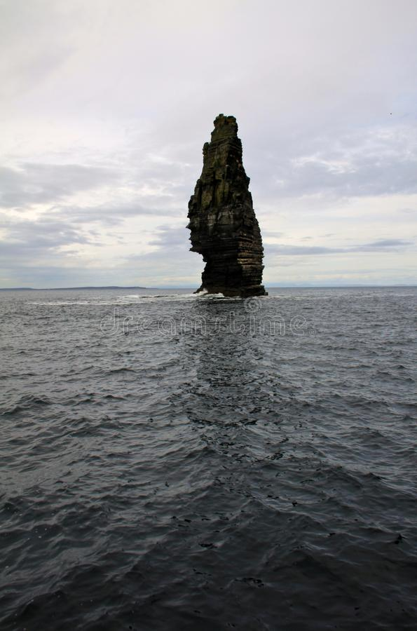 Isolated stone in the Cliffs of Moher, Ireland royalty free stock photos