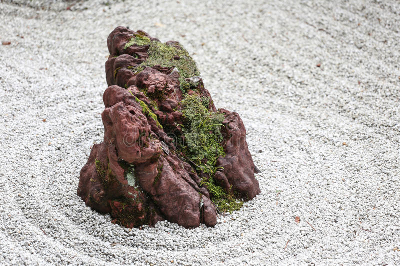 Stone Zen Garden Isolated stone in a japanese zen garden with white sand and moss download isolated stone in a japanese zen garden with white sand and moss stock photo workwithnaturefo