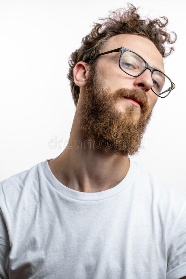 Mid - aged proud satisfied man with crossed arms looking at camera. stock image