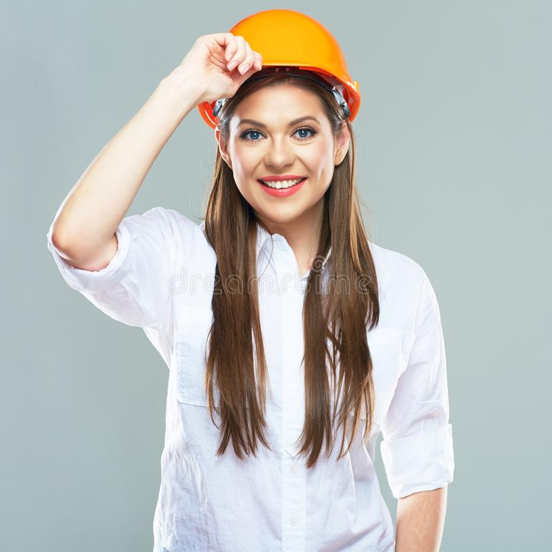 Isolated studio portrait of smiling woman manager of real estat. E. Business woman wearing protect helmet royalty free stock photos
