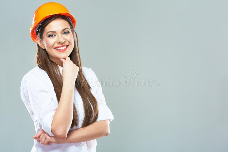 Isolated studio portrait of smiling woman manager of real estat. E. Business woman wearing protect helmet stock images