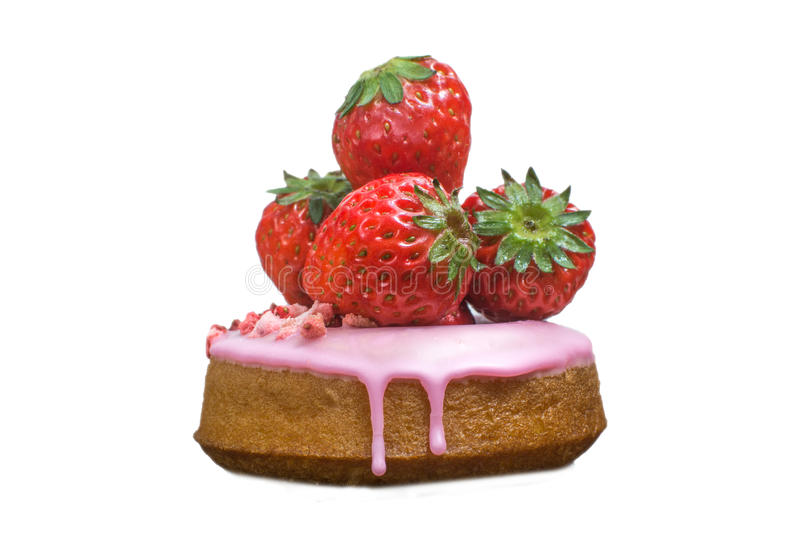 Isolated sweet donut in glaze and fresh strawberry on the white royalty free stock photo