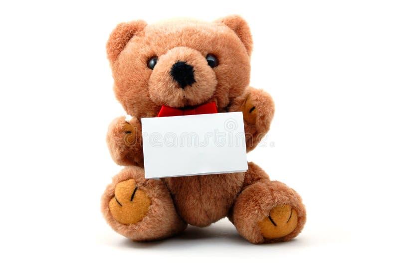 Isolated teddy with blank sheet. Toy teddy bear with blank sheet isolated on white background stock photo