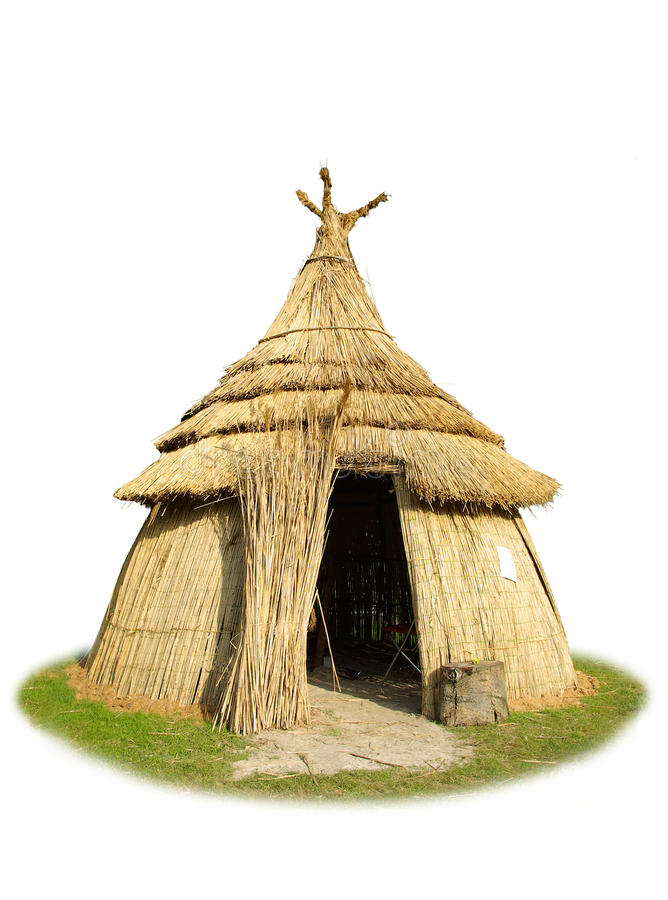 Isolated thatched hut. White background isolated picture of African thatched hut made of straw stock image