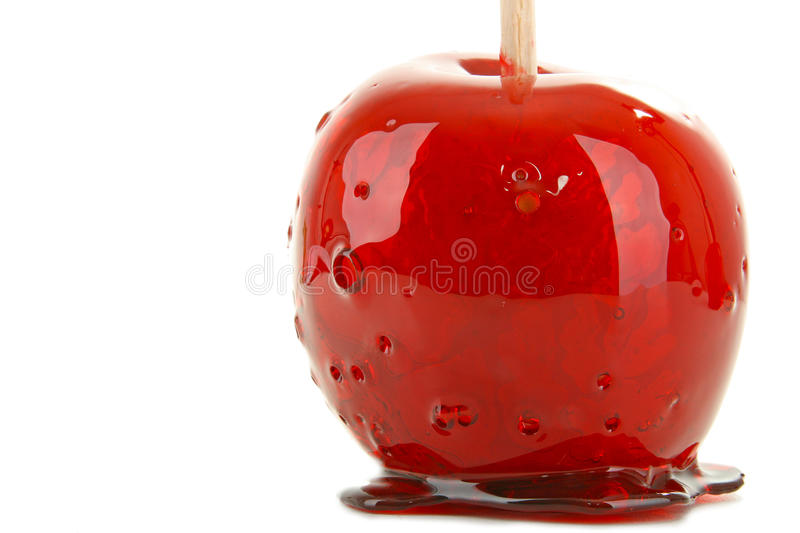 Isolated toffee apple. Sweet red toffee apple on white background stock photography