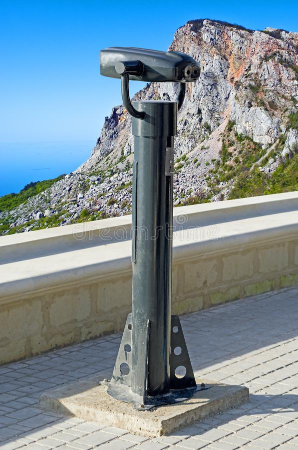 Isolated touristic telescope. Binocular against observation deck view stock images
