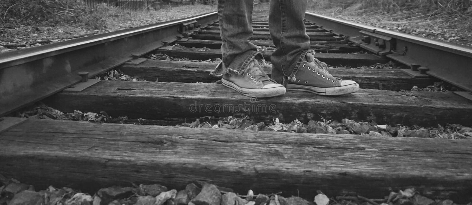 Isolated on tracks with my sneakers stock photography
