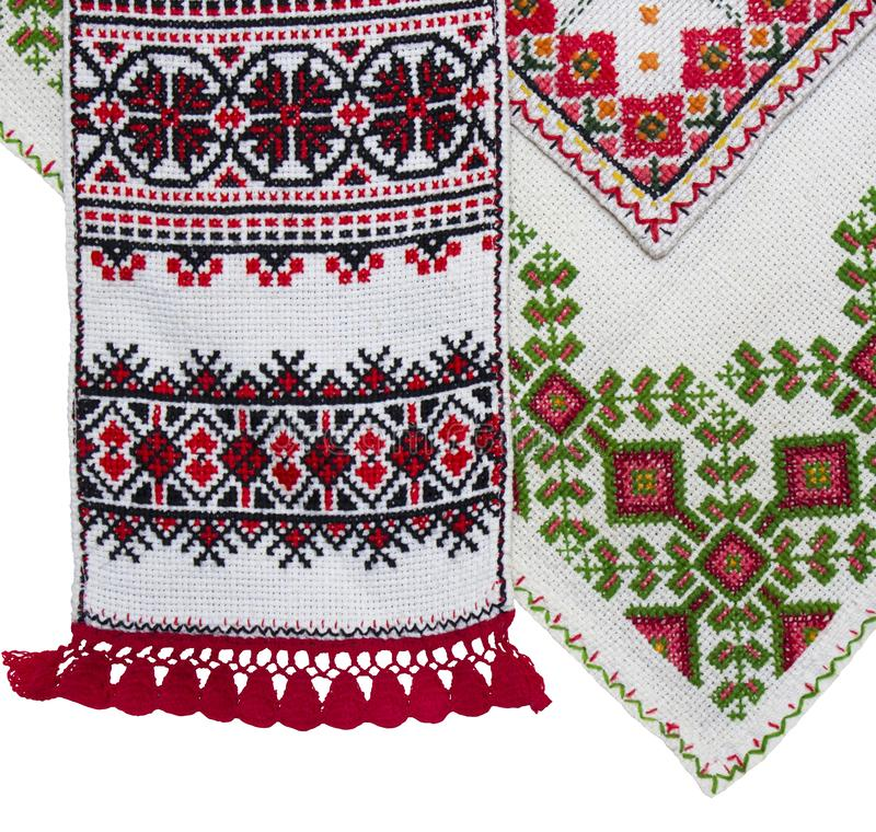 Isolated traditional Ukrainian embroidery. Embroidered napkins isolated on white background. Folk crafts, traditional Ukrainian embroidery. Napkins and stock photography