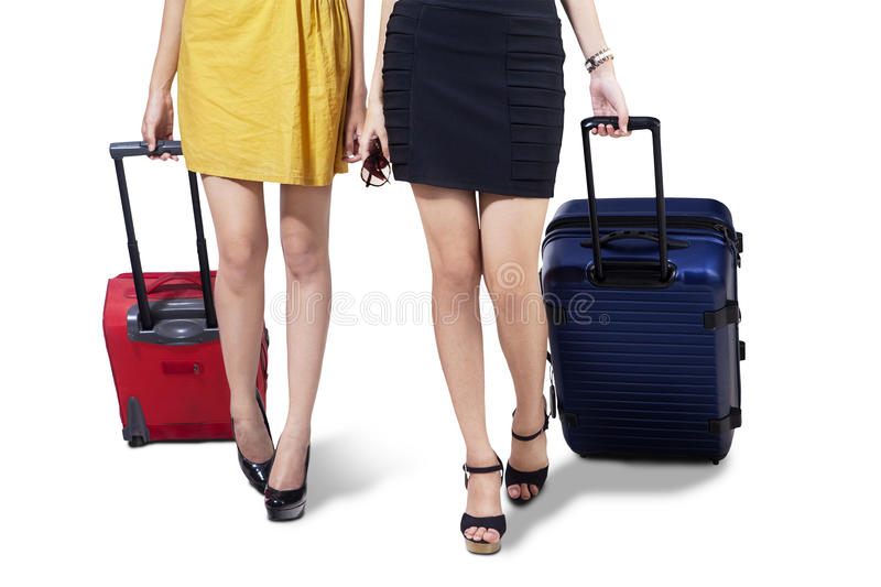 Isolated two woman with suitcase stock images