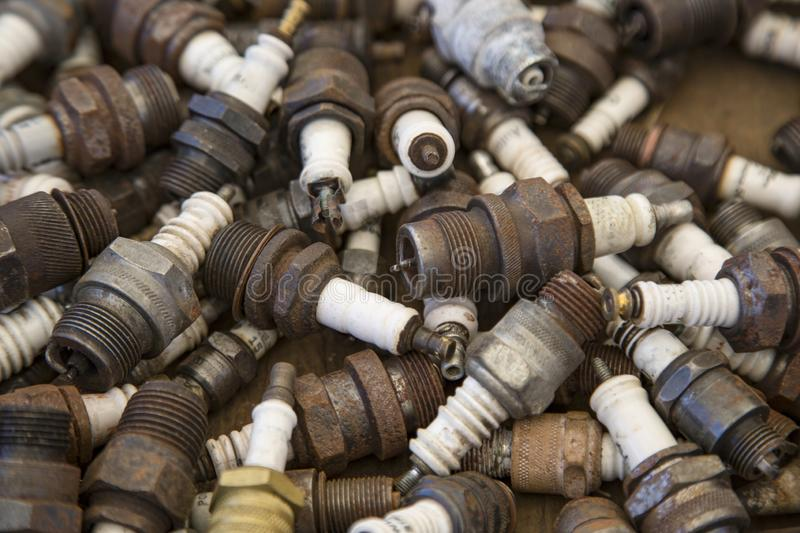 Isolated View of a Jumble of Old Used Spark Plugs stock images