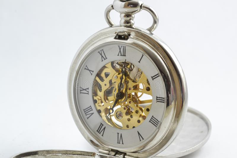 Beautiful vintage Pocket Watch. Isolated vintage pocket watch with exposed gears, see through body and spring powered royalty free stock photography