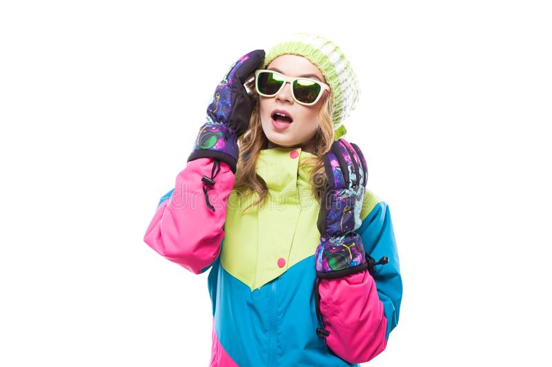 Young woman in ski suit and sunglasses royalty free stock photography