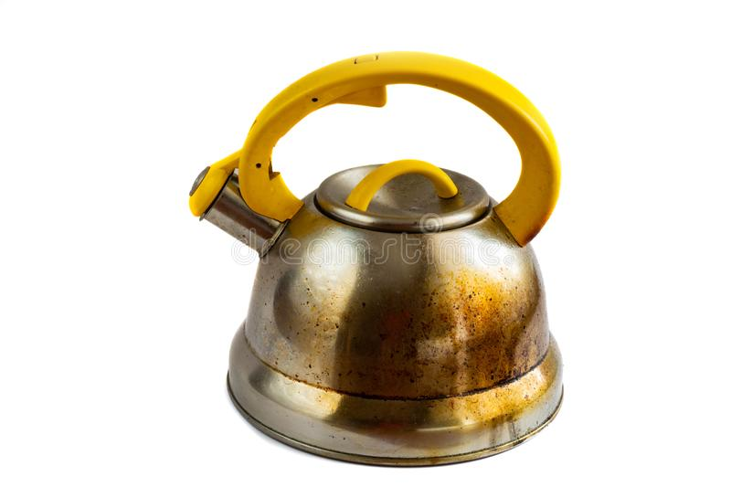 Isolated on white background dirty greasy whistling kettle.  royalty free stock photo