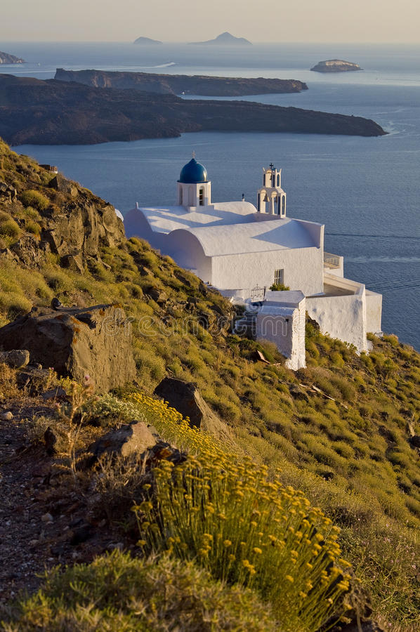 Isolated White Church by the Sea in Santorini royalty free stock photo