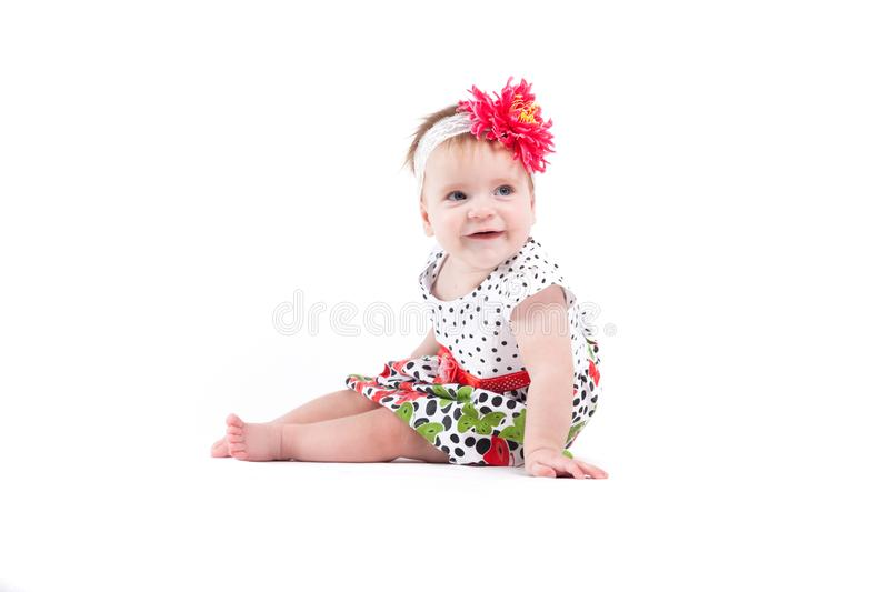 Cute beautiful baby girl in dot dress with butterflies and red w royalty free stock photos