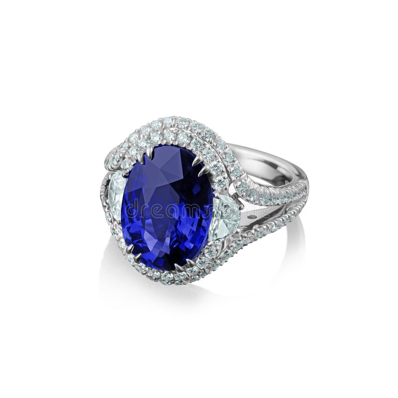 Isolated white gold ring with diamonds and huge blue sapphire stock images