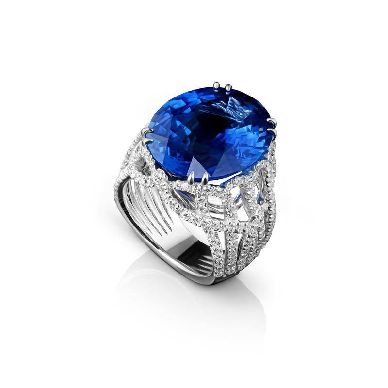 Isolated white gold ring with diamonds and huge blue sapphire royalty free stock photo