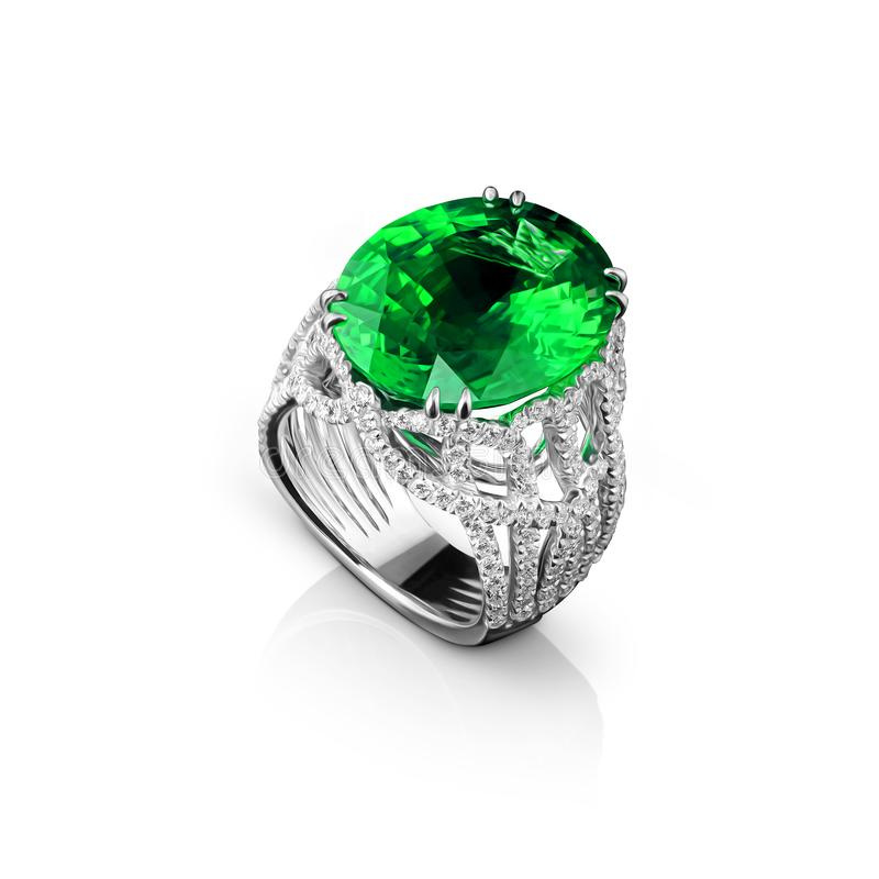 Isolated white gold ring with diamonds and huge green emerald stock image