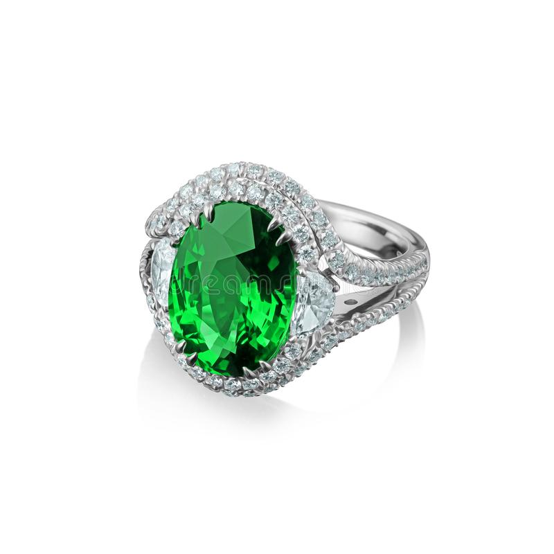 Isolated white gold ring with diamonds and huge green emerald.  royalty free stock images