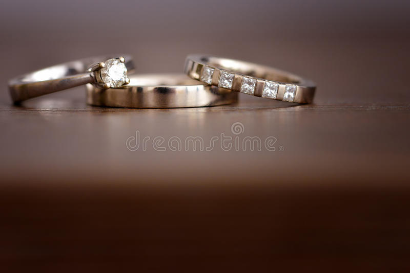 Isolated white gold wedding rings stock photography