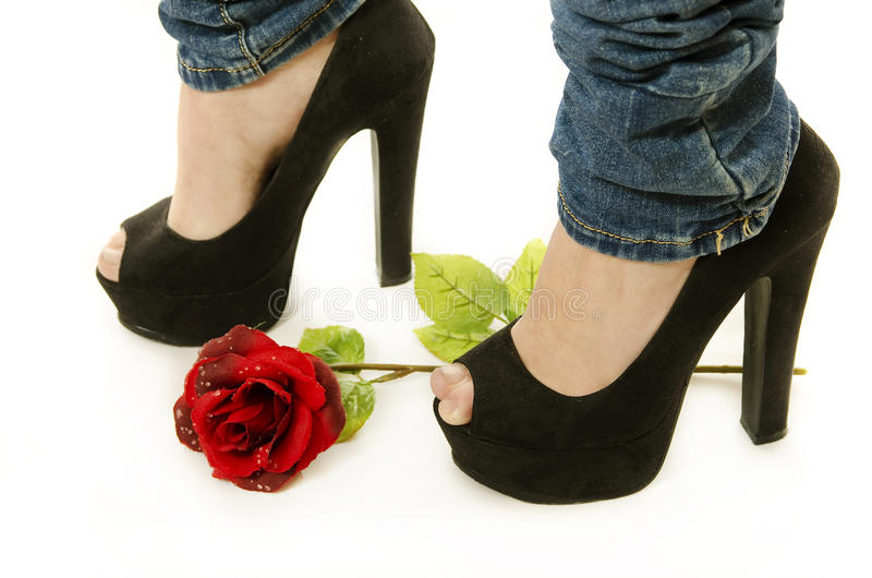 Jeans, heels and rose royalty free stock photography