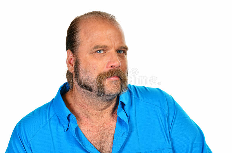 Isolated on white a man with mutton chops. Older man with a trimmed beard mutton chops royalty free stock images