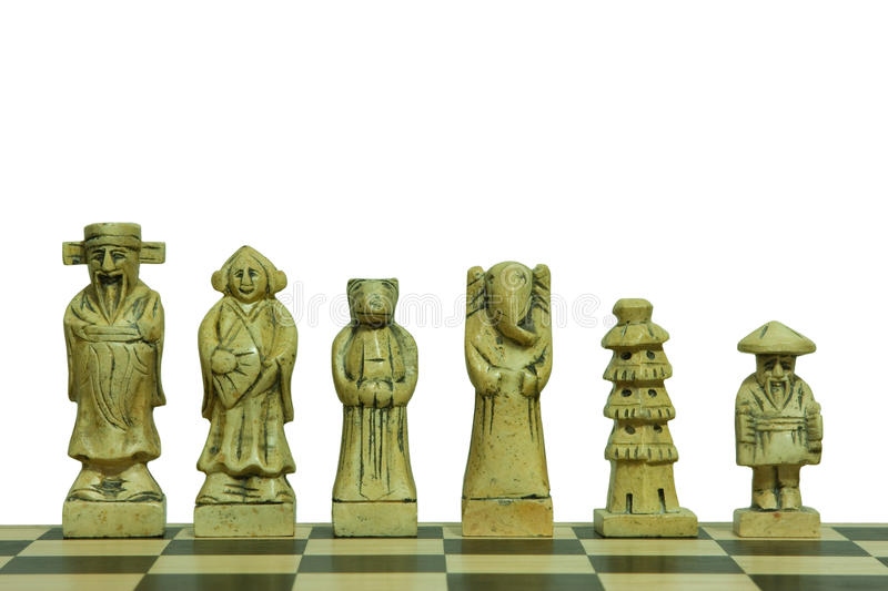 Isolated white stone chess pieces. Display of white pieces of a stone chess set isolated on white background royalty free stock photos