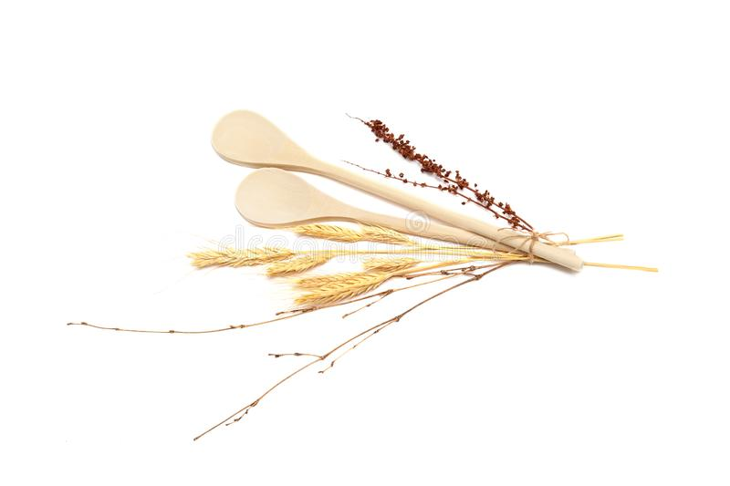 Isolated on white wheat with wooden spoons flatlay royalty free stock photography